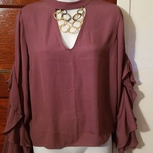 Ruffle sleeve blouse. Great condition